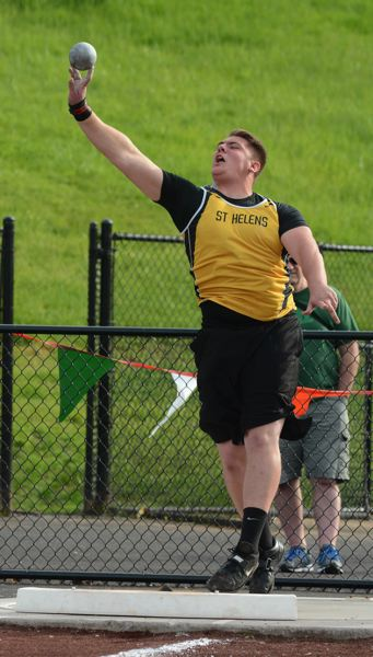 by: JOHN WILLIAM HOWARD - Jacob Zartman lets out a yell during his turn to throw in the third flight of shot put competition at the Northwest Oregon Conference championships on Friday in Sandy. Zartman advanced to the state championships with a second-place throw of 49 feet, 2.25 inches.