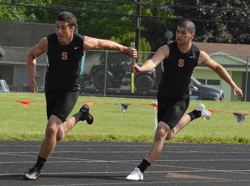 by: JOHN WILLIAM HOWARD - Jarrett White and Nick Rust make the first handoff in the 4x100 meter relay at the Cowapa League championships on Friday afternoon. The Scappoose boys won both relay events, and took home their fourth league track title in a row.