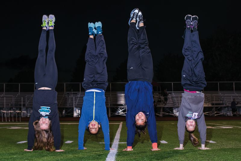by: HILLSBORO TRIBUNE PHOTO: CHASE ALLGOOD - Century's Kassie Morrison, Hilhi's Krissy Thomas, Liberty's Eli Pecsok and Glencoe's Courtney Vacek (left to right) all have turned early training in gymnastics into success in track and field.