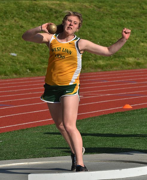 by: VERN UYETAKE - West Linn's Meghan Carbiener gets set to unleash a throw in the shot put last week. She won the event and has one of the best marks in the league in the shot put this year.