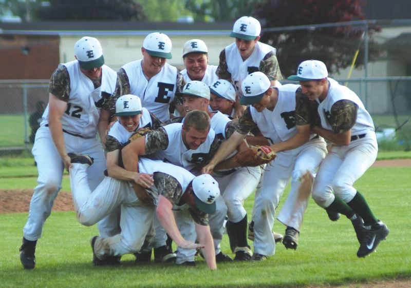 by: CONTRIBUTED PHOTO: BRENLEY BABIKOFF - Estacada players dogpile on the mound after Fridays 1-0 win over LaSalle to claim a share of the Tri-Valley Conference crown.