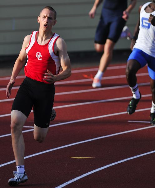 by: JOHN LARIVIERE - Oregon City freshman Jake Harthun won the 400-meter dash.