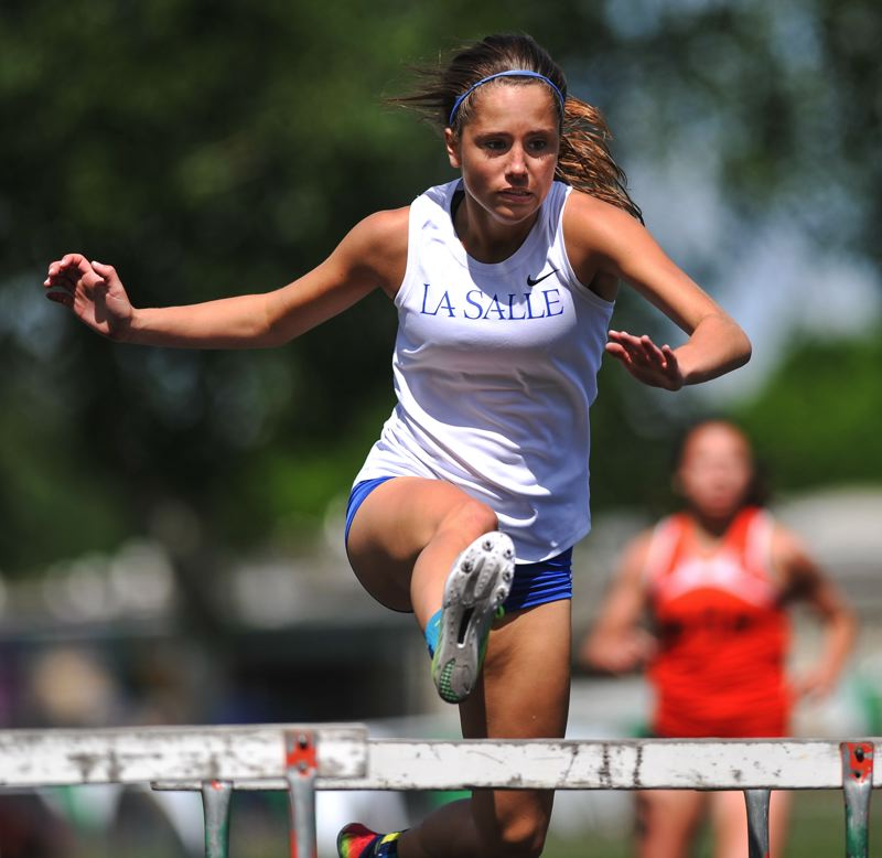 by: JOHN LARIVIERE - COURTNEY CRAIN EXCELS IN THE HURDLES