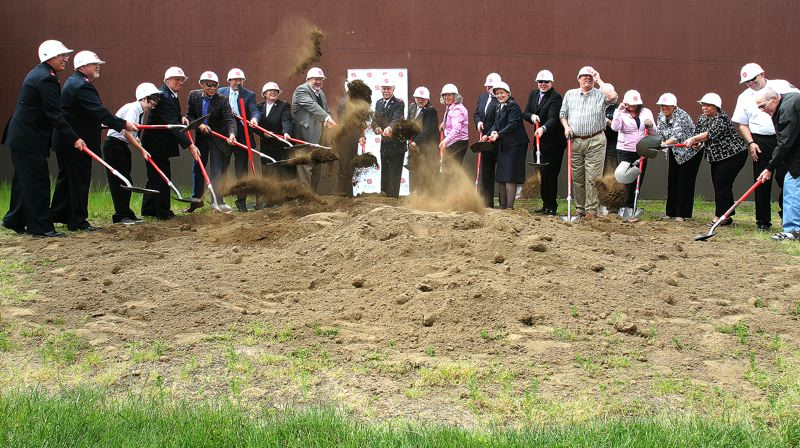 by: OUTLOOK PHOTO: JIM CLARK - The dirt flew at a goundbreaking ceremony last week for the Salvation Armys new Social Services Center.