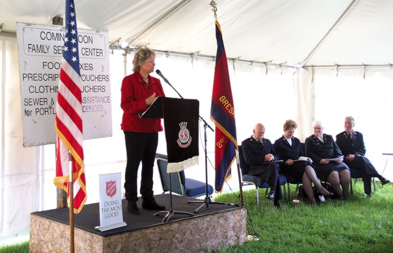 by: OUTLOOK PHOTO: JIM CLARK - Lynn Snodgrass, emcee for the groundbreaking for an expansion to more than double the size of The Salvation Army facility on Southeast 194th Avenue.
