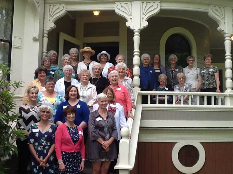 by: SUBMITTED - The ladies of PEO Chapter J gather outside the Settlemier House at their club's 100th birthday tea party Saturday.