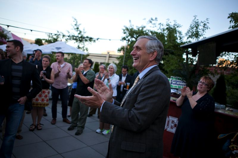 by: TRIBUNE PHOTO: ADAM WICKHAM - Portland Mayor Charlie Hales celebrated the defeat of a water district measure Tuesday evening at a Pearl District pub with others who opposed the intiative. The measure was widely defeated by voters in the primary election.
