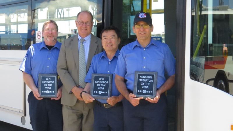 by: COURTESY TRIMET - Bus Operator Andy Church, TriMet General Manager Neil McFarlane, MAX Operator of the Year Jason Wang and Mini-Run/Part-Time Operator of the year Fernando Lopez.