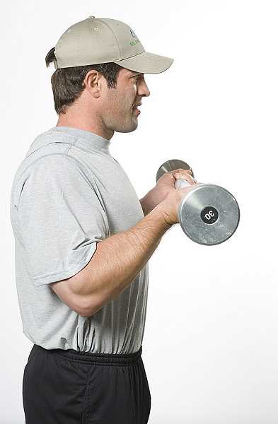 by: SUBMITTED - Slow & sure - This is the proper ending position for standing barbell curl.