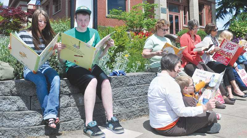 by: GARY ALLEN - Get out and read - Every year the Newberg Public Library encourages the community to take 15 minutes to 'Stop, Drop and Read.' This year the event takes place from 1:30 to 1:45 p.m. May 27.