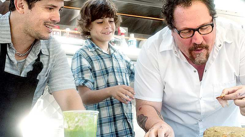 by: SUBMITTED - New film - In Jon Favreau's (right) new film 'Chef,' he rebuilds a relationship with his son (Emjay Anthony, center) with his trusty line cook at his side, portrayed by John Leguizamo (left). The trio cooks across the states in the movie, which opens Friday.