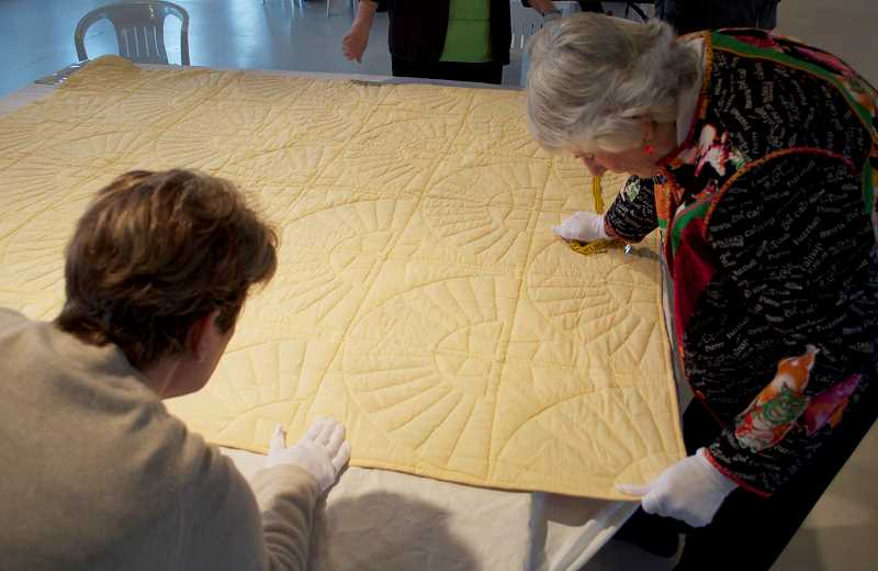 by: COURTESY PHOTO - Volunteers do a detailed analysis of a quilt to be entered into the Oregon Quilt Projects extensive database at an event like the one set for May 31 at the Washington County Museum.