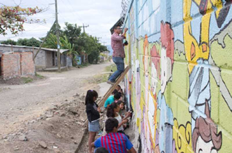 by: SUBMITTED PHOTO: BEN METCALF - Honduran artist Jose Carlos Alonzo led the community in painting the mural.