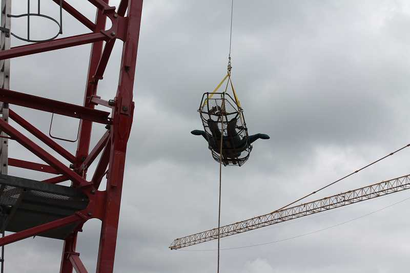 by: TIDINGS PHOTO: PATRICK MALEE - As part of a rescue training session, crews from Clackamas Fire and Tualatin Valley Fire and Recue lowered a dummy from the top of a tower crane at the LOT site.