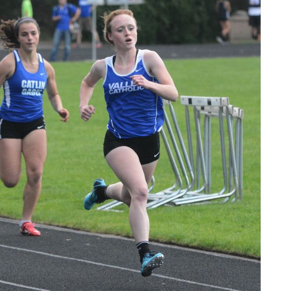 by: TIMES PHOTO: MATT SINGLEDECKER - Valley Catholic senior Sara Connelly took second in the 100-meter dash and was part of the Valiant 4x100 relay that also took first at the Lewis and Clark District Meet on Saturday.