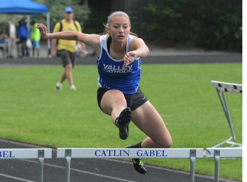 by: TIMES PHOTO: MATT SINGLEDECKER - Valley Catholic senior Mikaela Bernards won four events at the Lewis and Clark District Meet on Saturday including 300-meter hurdles.