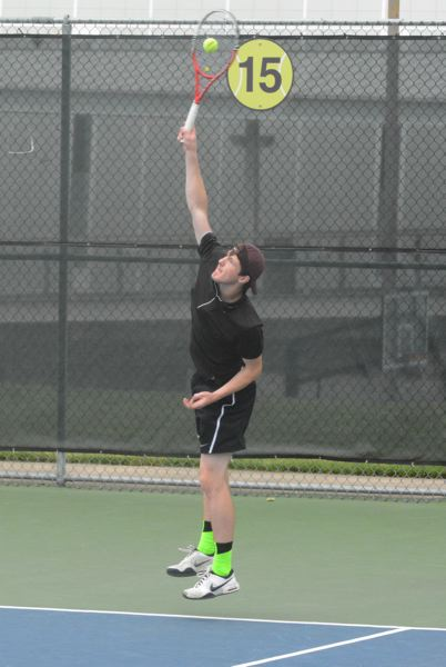 by: TIMES PHOTO: MATT SINGLEDECKER - Jesuit senior Nathan Lortz hits a serve at the Sunset doubles team in the Metro District Championship on Saturday. Lortz and Michael Quinn took first in Metro.