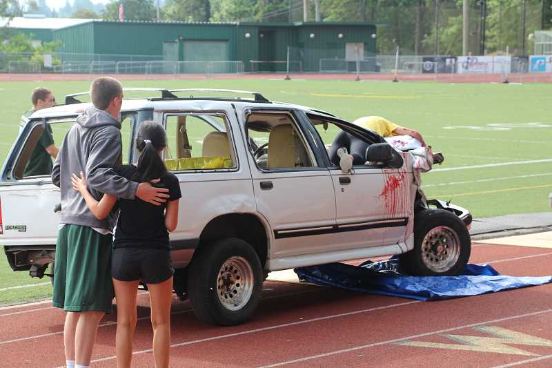 by: SUBMITTED PHOTO: NICOLE GRAY - WLHS students and parents worked with TVF&R, Washington County and West Linn law enforcement and other public agencies to stage an accident that graphically illustrates the consequences of drinking and driving.