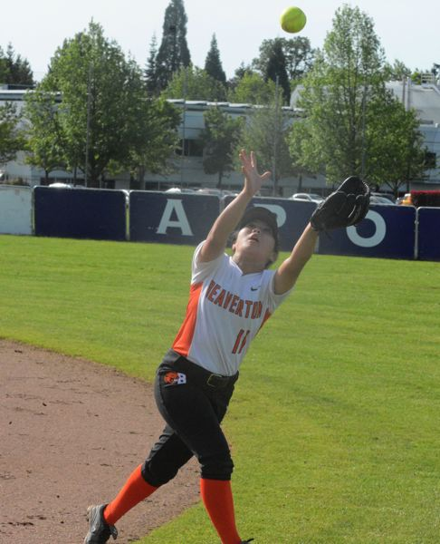 by: TIMES PHOTO: MATT SINGLEDECKER - Beaverton freshman infielder Anika Matsumota reaches up for a pop-up in the first inning against Sunset.