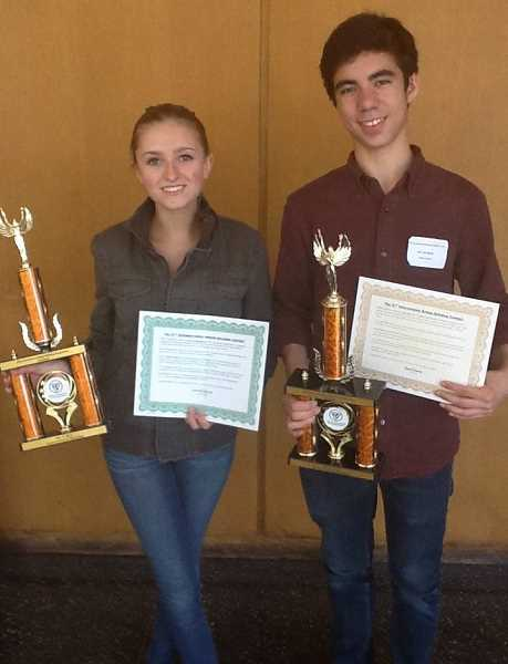 by: SUBMITTED PHOTO - Riverdale students Cole Bemis and Kate Hollingshead beam at the International Bridge Building Competition on May 10.