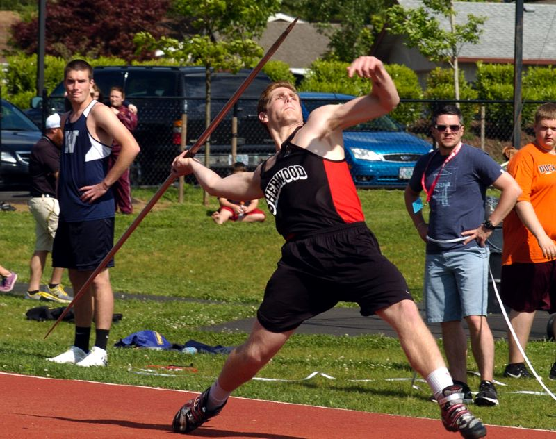 by: PAMPLIN MEDIA GROUP: PARKER LEE - AUSTIN POWERS -- Sherwood's Austin Goldstein took first place in the javelin competition at the NWOC district track and field championships.