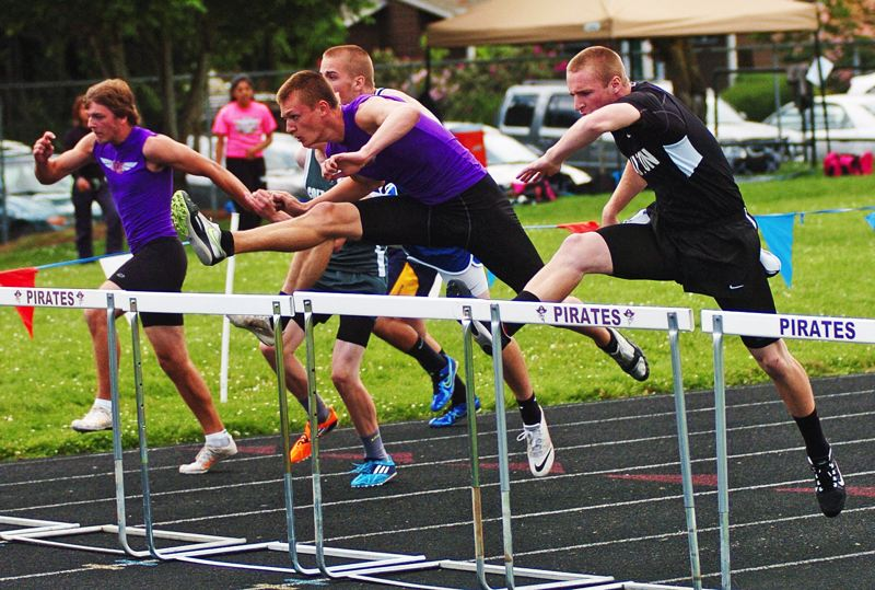 by: DAN BROOD - A LEG UP -- Horizon Christian's Blake Phillips is first over the hurdle on his way to winning the 110-meter high hurdles event Saturday at the West Valley League district meet.