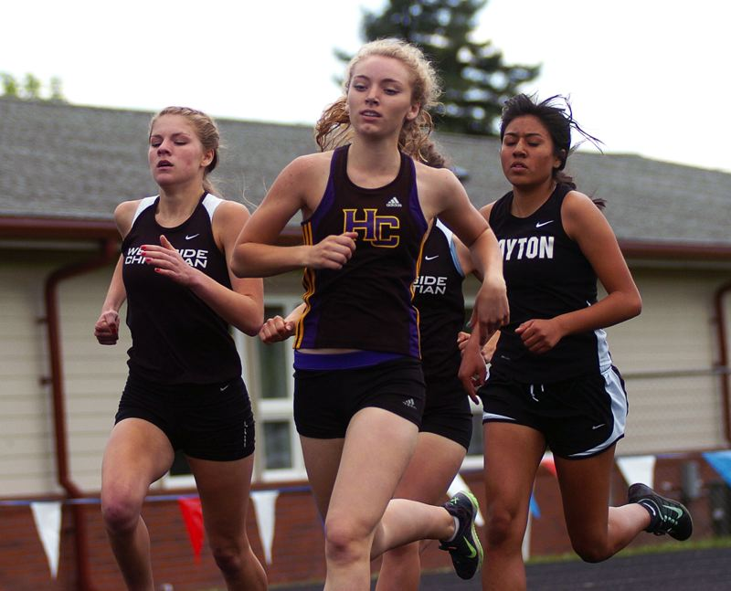 by: DAN BROOD - RUNNING HARD -- Horizon Christian's Hannah Cersario strides out during the 800-meter run Saturday at the West Valley League district track and field championships.
