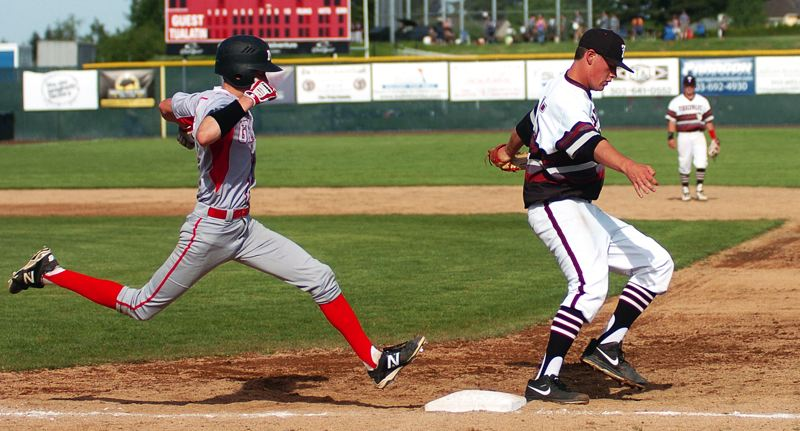 by: DAN BROOD - GOT HIM -- Tualatin junior Karter Cook (right) touches first base before McMinnville's David Brosius can get to the bag.