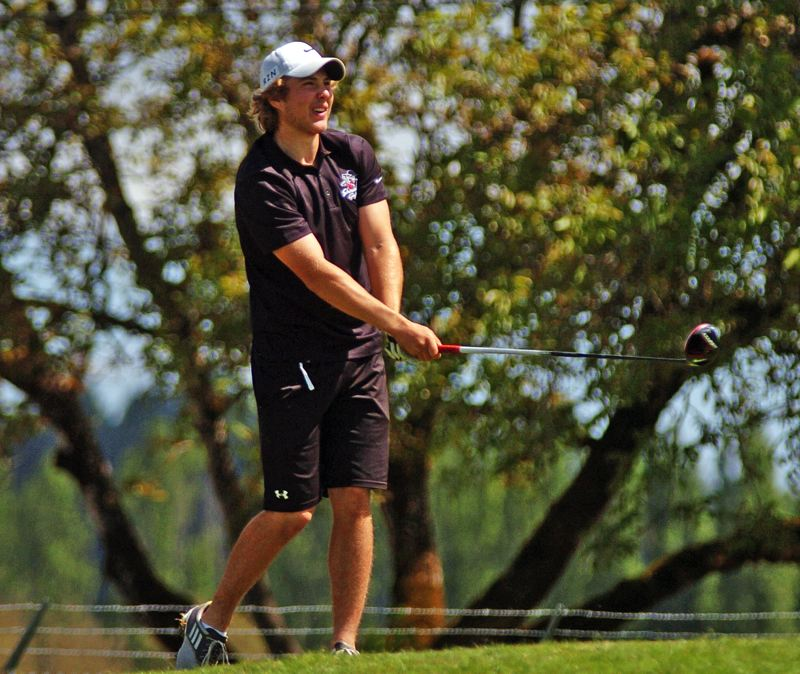 by: DAN BROOD - BIG HITTER -- Sherwood senior Keegan Brasch watches his drive on hole No. 17.
