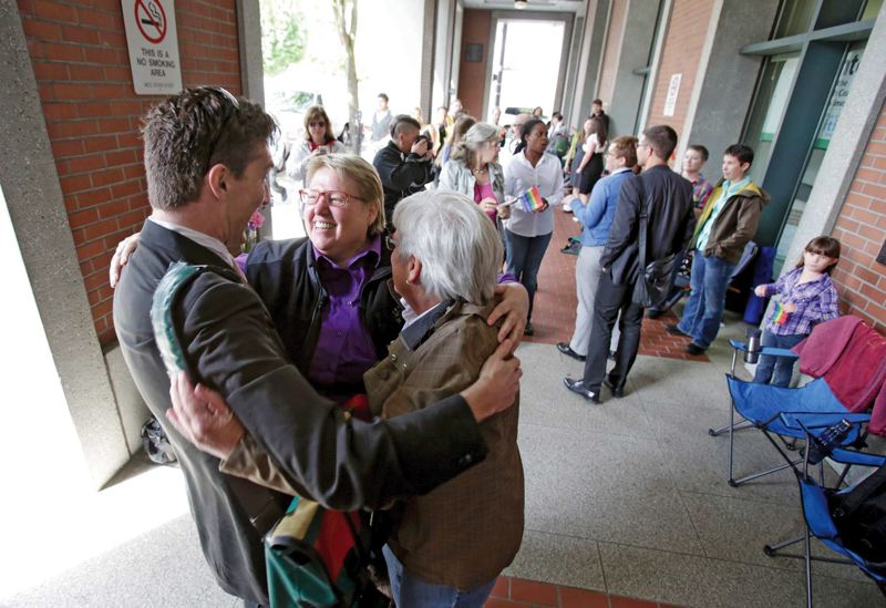 by: TRIBUNE PHOTO: JONATHAN HOUSE - Federal lawsuit plaintiffs Deanna Geiger and her partner Janine Nelson hugged their lawyer Monday morning while waiting for a marriage license in Multnomah County. A U.S. District Court judge struck down Oregons ban on same-sex marriage in a 26-page ruling at about noon Monday.