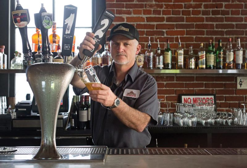 by: TRIBUNE PHOTO: JONATHAN HOUSE - BridgePort brewmaster Jeff Edgerton pours a pint of their special release Trilogy #2 IPA. The series commemorates 30 years of microbrews.