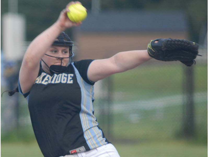 by: PAMPLIN MEDIA GROUP: DAVID BALL - Lakeridge pitcher Chayse Pearson winds up for a throw during Tuesdays 11-1 play-in victory over David Douglas.