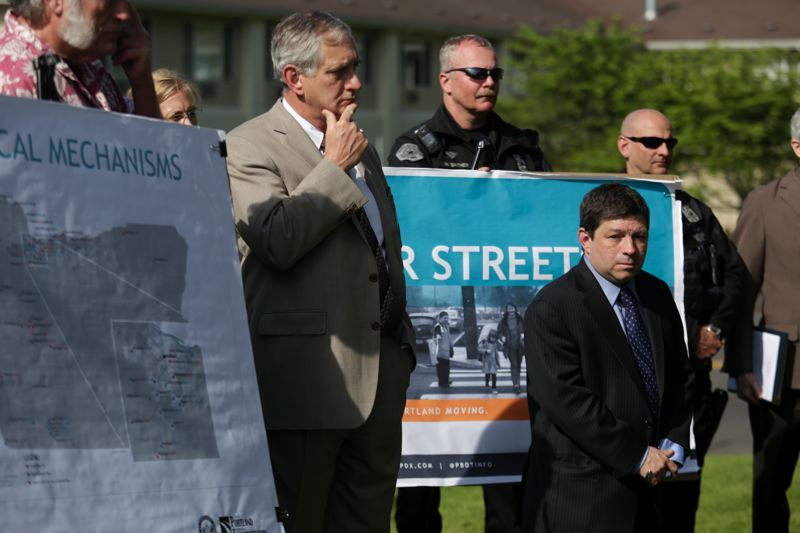 by: TRIBUNE PHOTO JONATHAN HOUSE - Mayor Charlie Hales and Portland City Commissioner Steve Novick listen during a press conference announcing a proposed Transportation User Fee for all Portland residences, businesses, governments and nonprofit organizations.