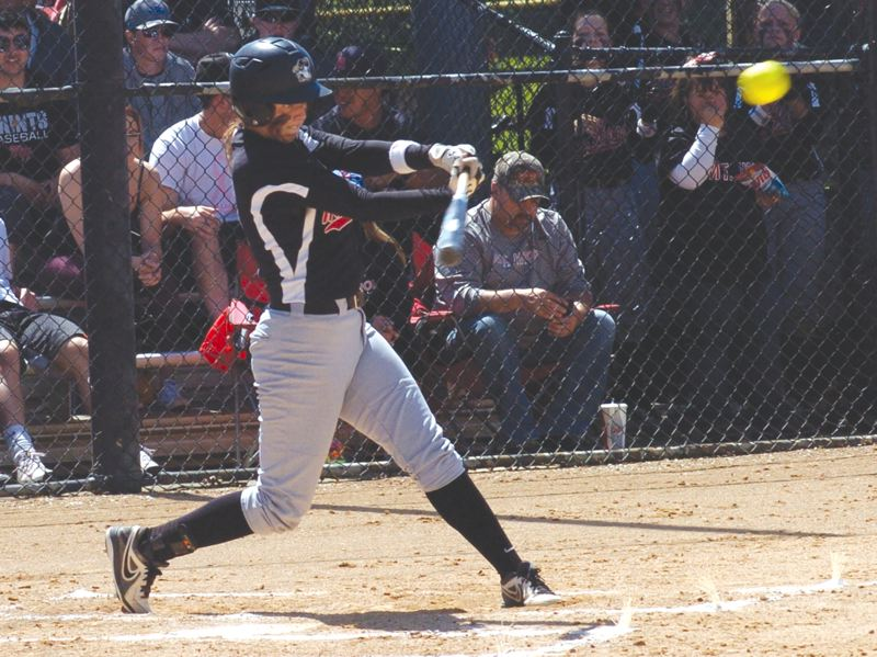 by: SANDY POST: PARKER LEE - Sandy High graduate Chelsea Spanier sends a hit in play during last weeks 4-2 title-game win over Clackamas CC. She had seven hits, including two homers, during the Northwest tournament.