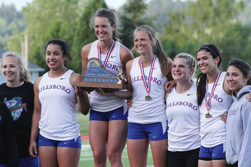by: HILLSBORO TRIBUNE PHOTO: AMANDA MILES - Members of the Hilhi girls track team pose with their Pacific Conference championship trophy last Friday after a dominant performance at the district track and field meet.