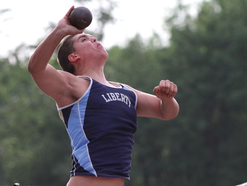 by: HILLSBORO TRIBUNE PHOTO: AMANDA MILES - Liberty's Jon Horn uncorks a personal-best throw of 50-8 1/2 to win the shot put at last week's NWOC district track meet.
