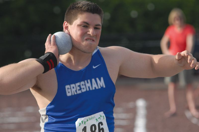 by: THE OUTLOOK: DAVID BALL - Gresham senior Brian Salgado came within inches of the lead on his final throw of the preliminaries Friday morning.
