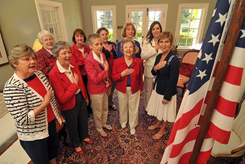 Members of the local DAR chapter begin their recent meeting at Oswego Heritage House with the Pledge of Allegiance.  DAR groups across the country have opened their meetings this way since 1890.