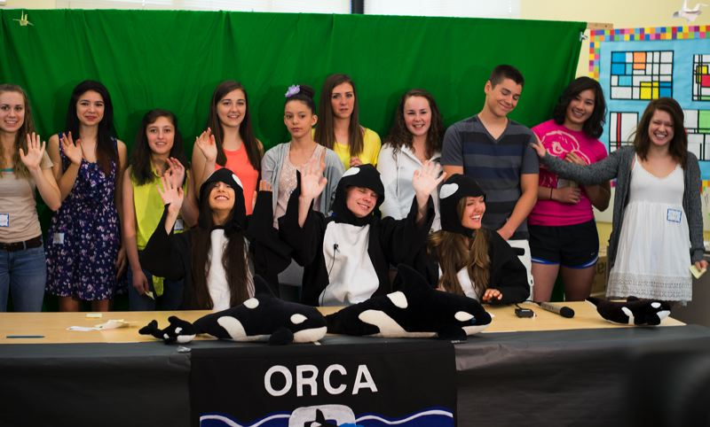 by: HILLSBORO TRIBUNE PHOTO: CHASE ALLGOOD - High school students who were crew members for Orca Live! when they were students at Orenco Elementary School sign off at the end of the anniversary broadcast.
