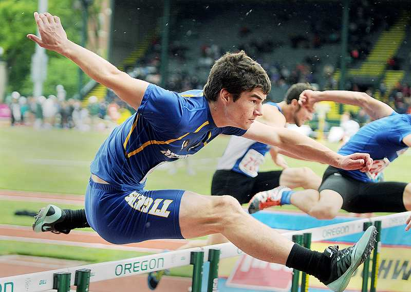 by: SETH GORDON - Up and over -- Newberg Zane Burgess glides over a hurdle midway through the second heat of qualifying for the 110 hurdles Saturday at the 6A state championships in Eugene. Burgess qualified fifth with a time of 14.97.