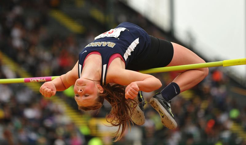 by: HILLSBORO TRIBUNE PHOTO: ZACK PALMER - Amy Hilger picked up a state championship for girls high jump.