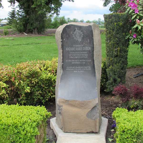 by: SUBMITTED PHOTO - On May 9, the Champoeg Chapter of the Oregon Society of the Daughters of the American Revolution dedicated this headstone to mark the final resting place of Madame Marie Dorion.