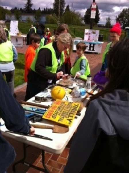 by: COURTESY OF NAOMI BELOV - Volunteers sort through an array of interesting object discovered during the annual Trashpoolza held April 26 at Cannery Square Plaza.