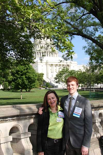 by: SUBMITTED PHOTO - Chris Kuiper stands in front of the U.S. Capitol with his mother in the spring of 2012, when he was selected to be  part of the Tourette Syndrome Association Youth Ambassador Program.