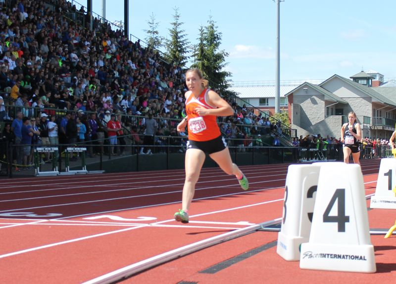by: JIM BESEDA/MOLALLA PIONEER - Molalla's Emily Bever won her third consecutive Class 4A girls' 800-meter run state title in a time of 2 minutes, 16.87 seconds during Saturday's finals of the OSAA track and field championships at Eugene's Hayward Field.