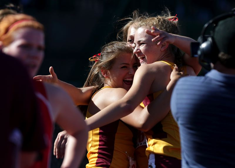 by: TRIBUNE PHOTO: JONATHAN HOUSE - The Central Catholic women's 4x400 meter relay team celebrates a win at State Championships.
