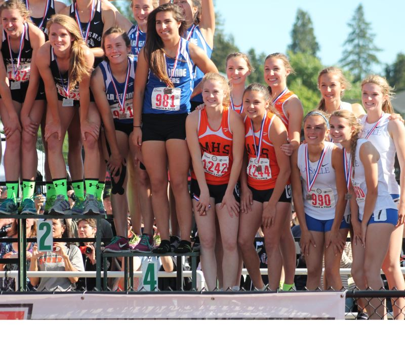 by: JIM BESEDA/MOLALLA PIONEER - Molalla's Josie Child (bib No. 1242), Audrey Bever, Desirae DesRosiers and Emily Bever placed sixth in the 4x400-meter relay with a season-best time of 4:08.78 Saturday at Hayward Field in Eugene.