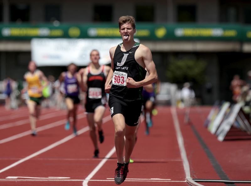 by: TRIBUNE PHOTO: JONATHAN HOUSE - Jesuit's Michael Godbout reacts after taking first place in the 6A 1500 meter run at the OSAA State Championships.