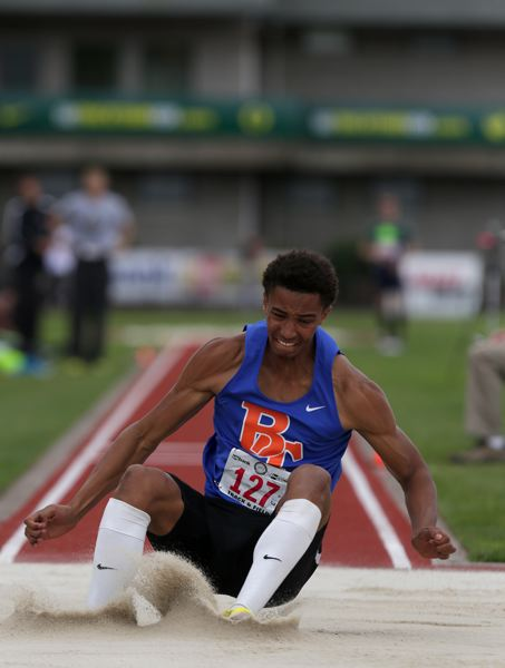 by: TRIBUNE PHOTO: JONATHAN HOUSE - Benson's Cameron Retherford broke a State Meet record in the Boys 5A Triple Jump.