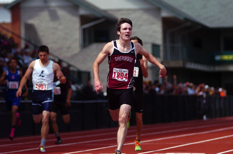 by: DAN BROOD - Sherwood senior Hunter Pfefferkorn is first across the finish line in the Class 5A boys 400-meter dash finals.